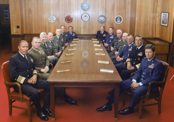 This is a group photograph of the Joint Chiefs of Staff and several Commanders in Chiefs taken on July 1, 1983, in the Chairman of the Joint Chiefs of Staff dining room, located in the Pentagon. Shows (left to right): U.S. Navy Adm. Wesley L. McDonald, Commander in Chief, US Atlantic Command; U.S. Marine Corps Gen. Paul X. Kelley, Commandant of the Marine Corps; U.S. Army Gen. Paul F. Gorman, Commander in Chief, US Southern Command; U.S. Army Lt. Gen. Robert C. Kingston, Commander in Chief, US Central Command; U.S. Army Gen. John A. Wickham, Chief of Staff, US Army; U.S. Army Gen. Wallace H. Nutting, Commander in Chief, US Readiness Command; U.S. Air Force Gen. James V. Hartinger, Commander in Chief, Aerospace Defense Command; U.S. Navy Adm. William J. Crowe, Commander in Chief, US Pacific Command; U.S. Air Force Gen. Charles A. Gabriel, Chief of Staff, U.S. Air Force; U.S. Army Bernard W. Rogers, Commander in Chief, US European Command; U.S. Army Gen. John W. Vessey, Jr., Chairman of the Joint Chiefs of Staff; U.S. Air Force Gen. Bennie L. Davis, Commander in Chief, US Strategic Air Command; U.S. Navy Adm. James D. Watkins, Chief of Naval Operations; and U.S. Air Force Gen. Thomas M. Ryan, Commander in Chief, Military Airlift Command. OSD Package No. A07D-00347 (DOD Photo by Robert D. Ward) (Released)