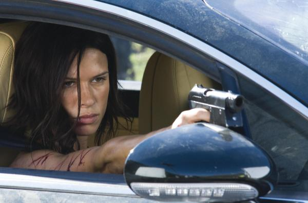 RHONA MITRA as DDS Major Eden Sinclair in an action-thriller about an elite group of specialists dispatched into a still-quarantined country to retrieve a cure to a dreaded virus?by any means necessary--?DOOMSDAY?.